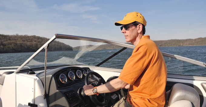Man piloting a boat